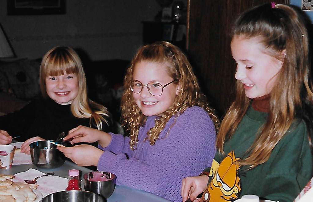 Gillian (on the left) makes Christmas cookies with her sisters Kendra and Hilary. Gillian would be 10 years old in this photo. [Terry C. Anderson photo; all rights protected]