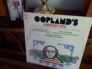 """My copy of Copland's """"Appalachian Spring."""" That's my brother Tony in the photo in the background. I couldn't help but put the album on to the """"record player"""" after I was able to track it down and pull it out from our multitudes of record albums. The record turns as though there's a slight warp in it, but I'm surprised by the lack of scratches in it. This particular recording was probably released in the late '60s or early '70s."""